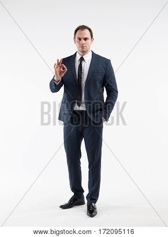 Portrait of a mature businessman in a suit on white background