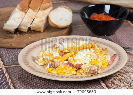 Fried eggs with bacon served on the table.