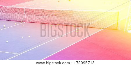 Tennis training equipment on court with color filters