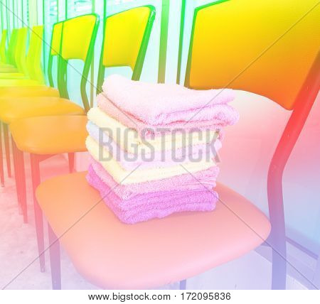 Stack of towels on chairs with color filters