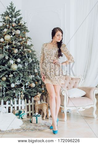Happy and yuong woman in Christmas decorations