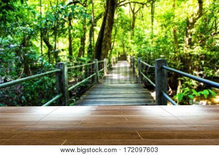 Abstract blur wooden bridge in the forest