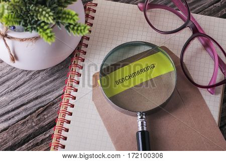 Business Concept : Benchmarking Written On Envelope With Wooden Background.