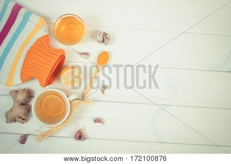 Hot Water Bottle, Cup Of Tea And Ingredients For Preparation Warming Beverage, Copy Space For Text