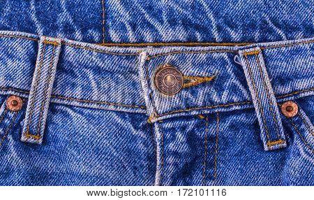 Chisinau Moldova February 17 2017: Close up of the LEVI'S button on the blue jeans. LEVI'S is a brand name of Levi Strauss and Co founded in 1853