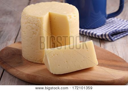 Cheese round on a rustic table