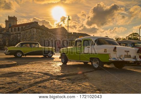 HAVANA,CUBA - FEBRUARY 15,2017 : Classic cars in Old Havana illuminated at sunset