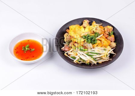 Fried Oyster Omelet With Herb Call Hoi Tod Khai.