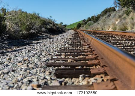 train track on gravel close up low angle