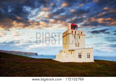 Beautiful white lighthouse at Cape Dyrholaey, South Iceland.