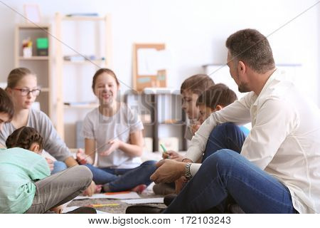 Male teacher conducting lesson at school