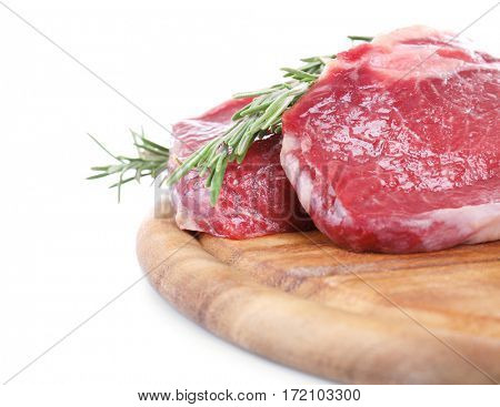 Raw steak with spices on cutting board, isolated on white
