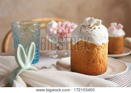 Easter cake in white plate on festive table