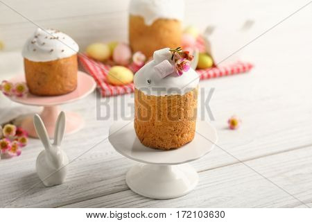 Stands with Easter cakes on wooden table
