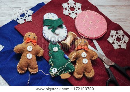 Christmas toy on a wooden table. Cute decorations on the Christmas tree. Creative art and craft idea for kids. top View