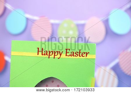 Easter concept. Closeup of greeting card on blurred background