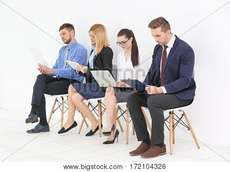 Group of people waiting for job interview on white background