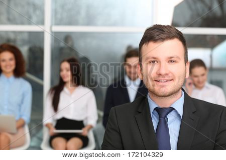 Job interview concept. Businessman standing in office hall