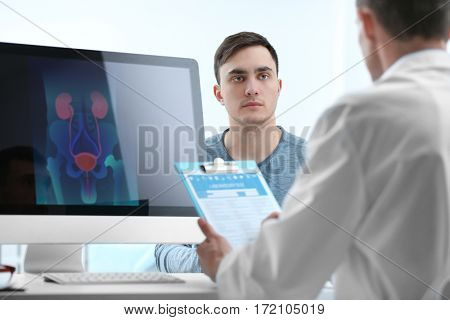 Medical concept. Doctor filling medical report and talking with patient