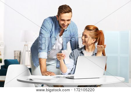 Young couple calculating taxes at home