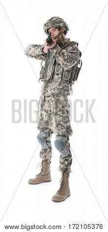 Soldier in camouflage taking aim, isolated on white