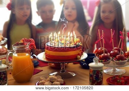 Tasty cake with candles at birthday party