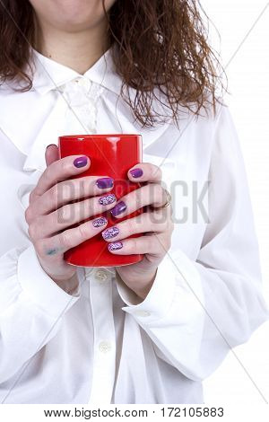 Orange ceramic cup of coffee in female hands