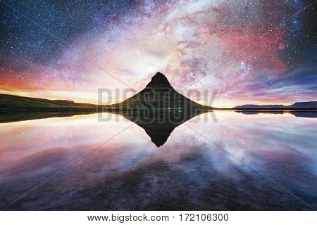 The picturesque sunset over landscapes and waterfalls. Kirkjufell mountain. Courtesy of NASA. Fantastic starry sky and the milky way. Iceland