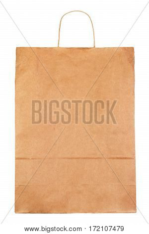 Kraft paper bag isolated on white background. Flat lay