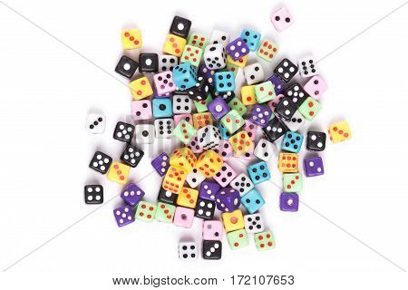 Colorful scattered gambling dice isolated on white background. Flat lay. Above view