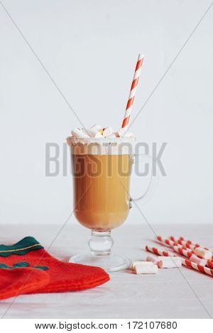 Christmas still life - cup of hot chocolate with marshmallows, candies and toys. New Year. Holiday card