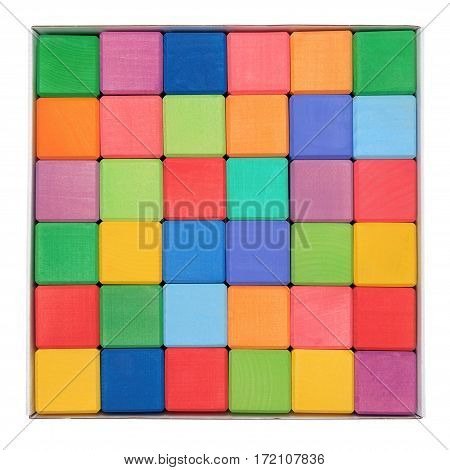 Colorful wooden blocks in paper box isolated on white background. Flat lay