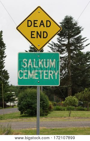 The irony of two road signs: a dead end at the cemetery