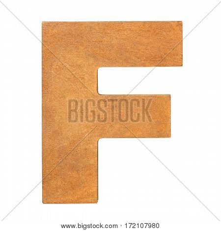 Old wooden letter F on wooden background. One of full alphabet wooden set