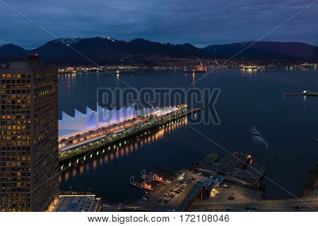 Canada Place and Vancouver harbour from above at night long exposure.