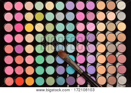 Makeup background. Colorful eye shadow palette with makeup brush