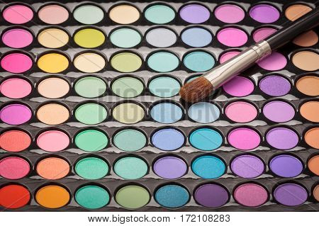 Makeup eyeshadow palette with makeup brush with copyspace