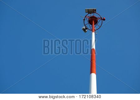 Transmission antenna radio tower pole on clear blue sky background
