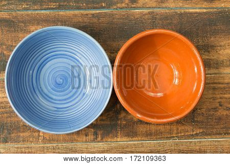 Empty bowl for the kitchen on a wooden background