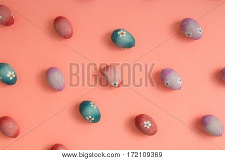 Colourful Easter Eggs ordered on a pink background