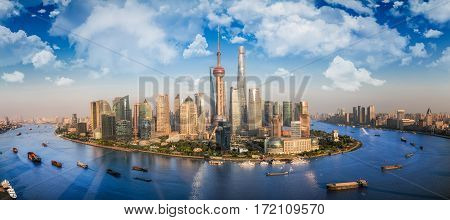 Shanghai city with river front and transprtation boat and blue sky shanng hai china asia