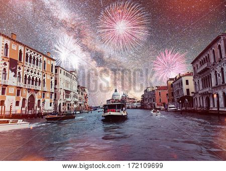 Rialto Bridge Ponte Di Rialto in Venice, Italy at night. Brightly Colorful Fireworks.