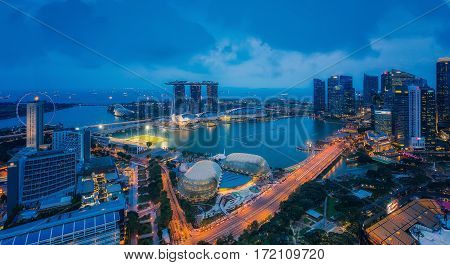Cityscape of Singapore and Marina bay sand area from view of hotel rooftop in night time