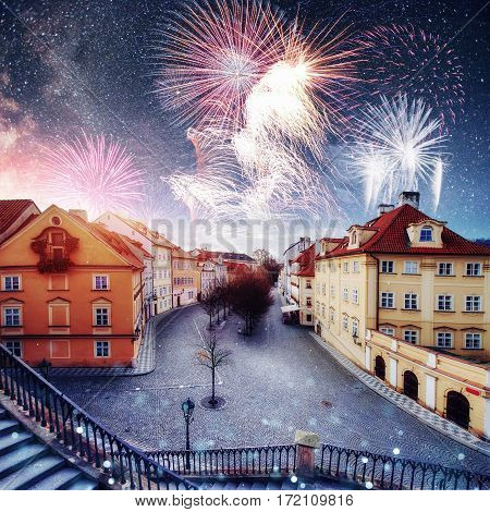 beautiful houses Czech Republic. Photo greeting card. Fantastic starry sky and the milky way. Colorful fireworks on the black sky background