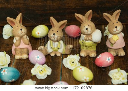 Easter decoration. Colourful eggs and funny rabbits