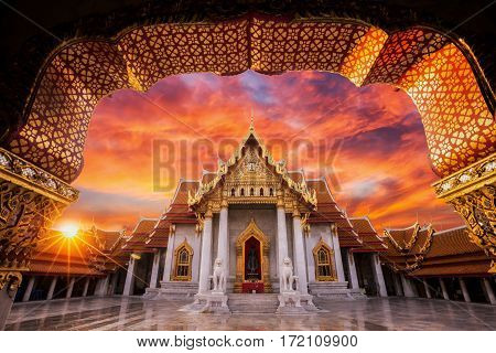 Wat benchamabophit The white marble temple with sunset in Bangkok Thailand. one of main land mark and travel point in Bangkok city