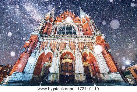 Church St. Joseph in Krakow. Fantastic starry sky. Photo greeting card. Bokeh light effect, soft filter. Poland.