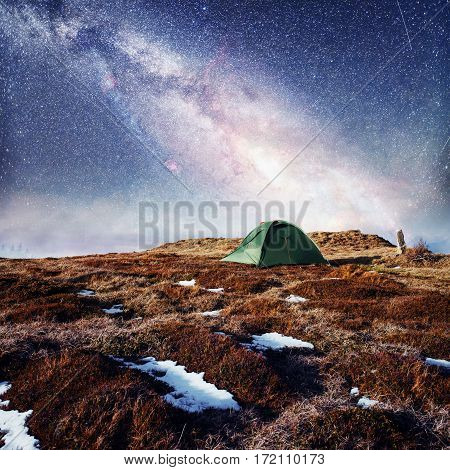 the starry sky above the tent in the mountains. Magic event in frosty day. In anticipation of the holiday. Dramatic scenes. Courtesy of NASA. Carpathians, Ukraine, Europe