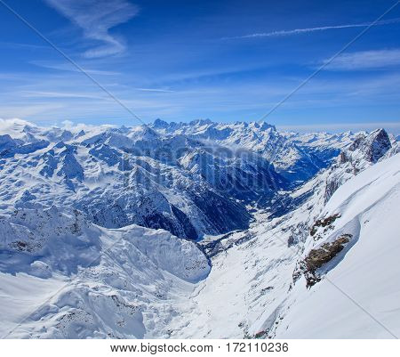 Alps in winter, view from Mt. Titlis. The Titlis is a mountain in Switzerland, located on the border between Swiss cantons of Obwalden and Bern.