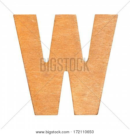 Old wooden letter W on wooden background. One of full alphabet wooden set